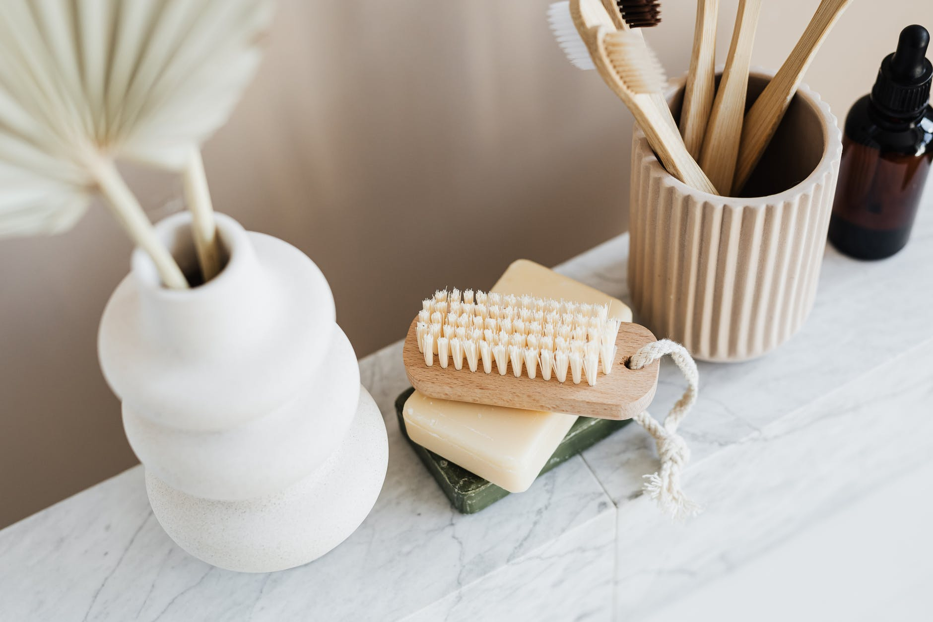set of natural toiletries on marble tabletop